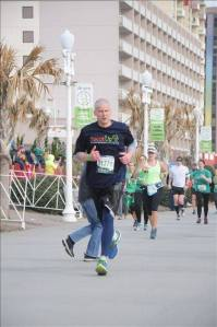 Approaching finish line at Shamrock Half in Virginia Beach, eyes on ocean sunrise and going for 26.2
